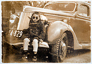 child posing with car Japan ca 1930s