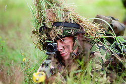 On a training area near Arlon in the Ardennes, troops of the East and West Riding Regiment (E&WRR) British Territorial Army, training in section attack, using Blank ammunition and Smoke Grenades.  Belgium. July 2002