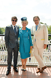 Left to right, TOM CRUISE and the EARL & COUNTESS OF MARCH at the 2014 Glorious Goodwood Racing Festival at Goodwood racecourse, West Sussex on 31st July 2014.