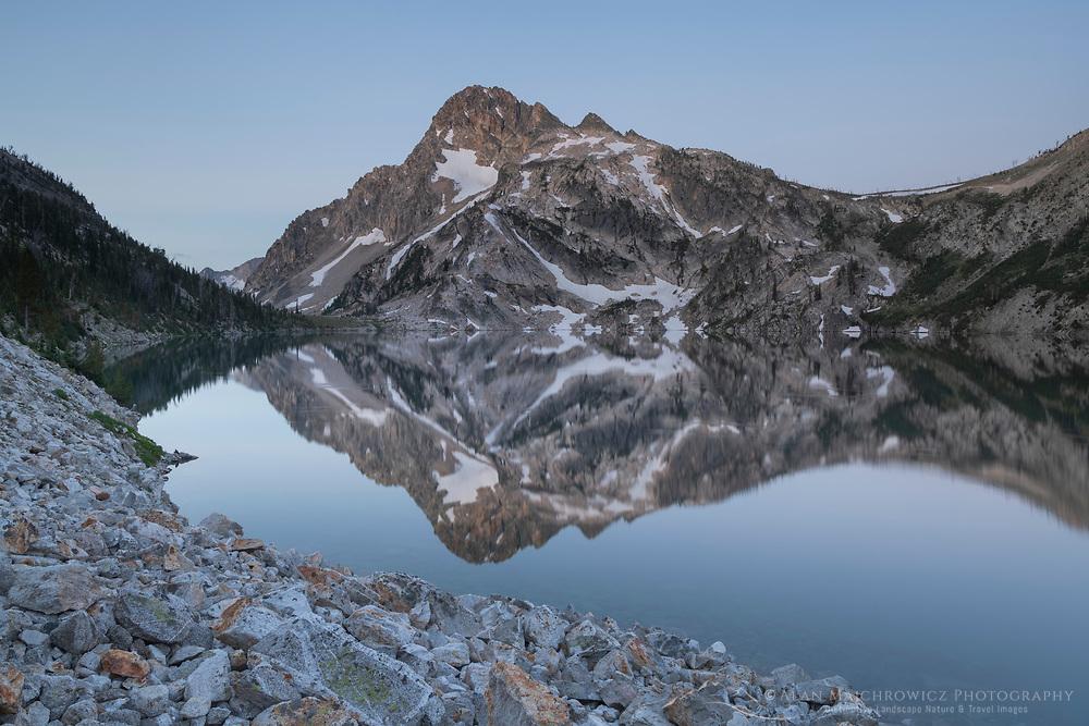Mount Regan mirrored in still waters of Sawtooth Lake, Sawtooth Mountains Wilderness Idaho