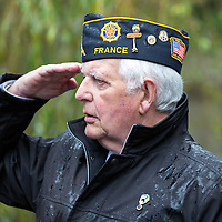 Commander Pat Mulcahy saluting during the 2 minute silence at the monument unveiling
