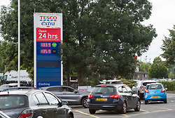 © Licensed to London News Pictures; 25/09/2021; Bristol, UK. Cars queue for fuel at Tesco Eastgate filling station after a fuel tanker had delivered more fuel soon after the filling station ran out of unleaded petrol. The UK has a fuel crisis with shortages at filling stations caused by a lack of HGV lorry drivers to deliver fuel, and from people panic buying and queueing for fuel. Photo credit: Simon Chapman/LNP.