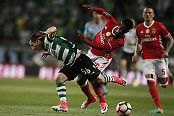 April 22, 2017 - Lisbon, Portugal - Sporting's midfielder Daniel Podence  (L) vies for the ball with Benfica's defender Nelson Semedo  (R) during Premier League 2016/17 match between Sporting CP vs SL Benfica, in Lisbon, on April 22, 2017. (Credit Image: © Carlos Palma/NurPhoto via ZUMA Press)