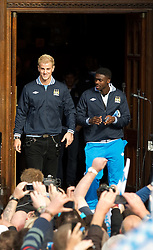© licensed to London News Pictures. Manchester, UK  23/05/2011. Joe Hart (left) & Paulo Torre (right). Tens of thousands of fans line the streets of Manchester as Manchester City Football Club hold an open-topped bus parade through the city. The team are celebrating winning the FA Cup, their first trophy in 35 years, and for qualifying for next season's Champions League. Please see special instructions for usage rates. Photo credit should read Joel Goodman/LNP
