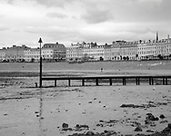 The Beach and Pier in Llandudno, North Wales near Conwy. This black and white image shows the interesting shapes and textures to be found in this historic Victorian holiday resort on the North Wales coast. Just before spring I decided I wanted to try and capture the beaches of the holiday resorts of North Wales shown here having survived the dark winter months and ready for a new summer. <br /> <br /> Llandudno had had good reports and so off I went. I spent the day wondering around the beach, town and pier and this was one of the best images I managed to get. The post allows a focal point to this otherwise fairly bleak and open beach, with only a few passers by in the distance and only a couple of Heron Gulls for company. <br /> <br /> This image is ready to download for personal or commercial use and to order as a limited edition print. I will only make available 50 prints of this image, you can choose to have it printed on canvas or as a framed or unframed print ensuring you have an exclusive peace of highly collectable photo art to add to any home or business.