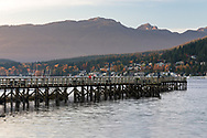 View of the recreational pier at Rocky Point Park in Port Moody, British Columbia, Canada.  The water surrounding the pier is Burrard Inlet.