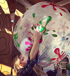 """Jessica Simpson releases a photo on Twitter with the following caption: """"""""Of course my kids would find the biggest beach balls to blow up. #HappyFirstDayofSummer"""""""". Photo Credit: Twitter *** No USA Distribution *** For Editorial Use Only *** Not to be Published in Books or Photo Books ***  Please note: Fees charged by the agency are for the agency's services only, and do not, nor are they intended to, convey to the user any ownership of Copyright or License in the material. The agency does not claim any ownership including but not limited to Copyright or License in the attached material. By publishing this material you expressly agree to indemnify and to hold the agency and its directors, shareholders and employees harmless from any loss, claims, damages, demands, expenses (including legal fees), or any causes of action or allegation against the agency arising out of or connected in any way with publication of the material."""