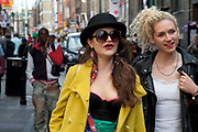 Highly fashionable people on Brick Lane in the East End of London. This area of London is known for it's eclectic, brilliant, sometimes bizarre fashion as young people gather on Sunday, market day, and time for people to gather, hang out, and parade their style.