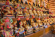 23 OCTOBER 2012 - HAT YAI, SONGKHLA, THAILAND: A wall of Buddhas at Wat Ta Won Vararum, a Chinese Buddhist temple in Hat Yai. The Vegetarian Festival is celebrated in Thai-Chinese communities throughout Thailand. It is the Thai Buddhist version of the The Nine Emperor Gods Festival, a nine-day Taoist celebration celebrated in the 9th lunar month of the Chinese calendar. For nine days, those who are participating in the festival dress all in white and abstain from eating meat, poultry, seafood, and dairy products. Vendors and proprietors of restaurants indicate that vegetarian food is for sale at their establishments by putting a yellow flag out with Thai characters for meatless written on it in red.   PHOTO BY JACK KURTZ