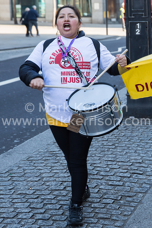 London, UK. 26th February, 2019. Susana Benavides , who was last week awarded £75,000 in compensation by an employment tribunal after being dismissed unfairly from her subcontracted cleaning job at Topshop, marches with mainly migrant striking outsourced workers belonging to the Independent Workers of Great Britain (IWGB), United Voices of the World (UVW) and Public and Commercial Services Union (PCS) trade unions working at the University of London (IWGB), Ministry of Justice (UVW) and Department for Business Energy and Industrial Strategy (PCS), together with representatives of the National Union of Rail, Maritime and Transport Workers (RMT) Regional Council, taking part in a 'Clean Up Outsourcing' demonstration to call for an end to the practice of outsourcing. The demonstration was organised to coincide with a significant High Court hearing of an application by the IWGB for judicial review of a decision by the Central Arbitration Committee (CAC) not to hear their application for trade union recognition for the purposes of collective bargaining with the University of London.