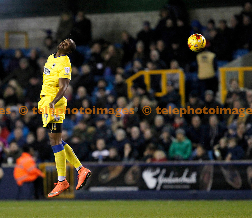 AFC Wimbledon's Tom Elliott wins the header during the Sky Bet League 1 match between Millwall and AFC Wimbledon at The Den in London. November 22, 2016.<br /> Carlton Myrie / Telephoto Images<br /> +44 7967 642437