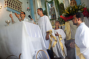 Priests conducting the ceremony. Often the lines between Candomble and Catholicism are blurred. This is especially true with the Sao Lazaro event in late January in Salvador, Bahia, Brazil, the city which is known as the home of Candomble. Sao Lazaro represents healing and the sick.