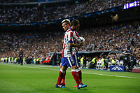Atletico del Madrid´s Griezmann and Koke during quarterfinal second leg Champions League soccer match at Santiago Bernabeu stadium in Madrid, Spain. April 22, 2015. (ALTERPHOTOS/Victor Blanco)