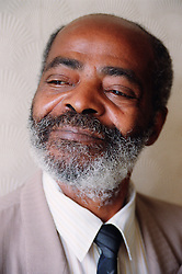 Portrait of elderly man looking thoughtful,
