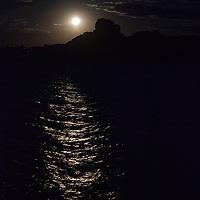 South America, Peru, Laka Titicaca. Full moon rises over Lake Titicaca.