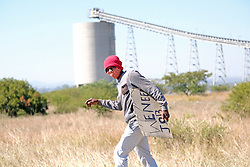 RUSTENBURG SOUTH AFRICA - MAY 18: A protester with his placard returning home near the Seraleng mining community on May 18, 2020, in Rustenburg, South Africa. Seraleng residents gathered at Sibanye k5 mine shaft Communities in the area alleged complaints of food parcel corruption by a local ward councillor. Grievances also included concerns with unemployment, loss of business and access to a social labour plan. (Photo by Gallo Images/Dino Lloyd)