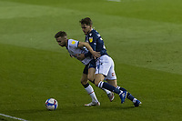 Football - Sky Bet Championship - Millwall vs Luton Town - The Den<br /> <br /> Martin Cranie (Luton Town) holds back Connor Mahoney (Millwall FC) to shield the ball<br /> <br /> COLORSPORT/DANIEL BEARHAM