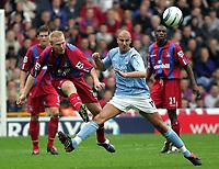 Photo:  Frances Leader.Digitalsport<br /> Crystal Palace v Manchester City.  Barclays Premiership. Selhurst Park.<br /> 18/09/2004<br /> Sandor Torghelle is tackled by Man City's Antoine Sibierski.