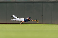 Ben Revere (11) of the Minnesota Twins attempts a diving catch during a game against the Detroit Tigers on August 14, 2012 at Target Field in Minneapolis, Minnesota.  The Tigers defeated the Twins 8 to 4.  Photo: Ben Krause