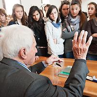 VENICE, ITALY - APRIL 03:  Ê Auschwitz Survivor Antonio Boldrin talks to a classroom telling the story of his life while holding the metal stamp with his concentration camp number on April 3, 2012 in Venice, Italy. Sentenced to death and already in front of the execution fire squad Boldrin was rescued by the Russian Army and was one of the few lucky prisoners that managed to survive the concentration camp.  (Photo by Marco Secchi/Getty Images)