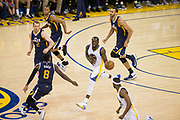 Golden State Warriors forward Draymond Green (23) handles the ball against the Utah Jazz during Game 2 of the Western Conference Semifinals at Oracle Arena in Oakland, Calif., on May 4, 2017. (Stan Olszewski/Special to S.F. Examiner)