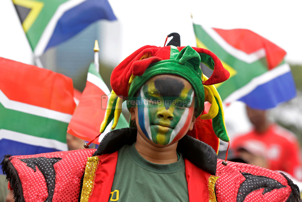 Monday 11th November 2019.<br /> City Hall, Grand Parade,<br /> And City Centre, Cape Town,<br /> Western Cape,<br /> South Africa.<br /> <br /> SPRINGBOKS CELEBRATE WINNING THE RUGBY WORLD CUP CHAMPIONSHIP IN 2019 WITH A COUNTRYWIDE VICTORY TOUR!<br /> <br /> SPRINGBOKS RUGBY WORLD CUP VICTORY TOUR CAPE TOWN!<br /> <br /> Abdue Dayaan (10) dressed in his Cape Minstrels jester costume and South African flaf face paint waits on Cape Town's Grand Parade for the Springboks to arrive.<br /> <br /> The reigning Rugby World Cup Champions namely the South African Springbok Rugby Team, celebrates winning the Webb Ellis Cup during the International Rugby Football Board Rugby World Cup Championship held in Japan in 2019 with their Victory Tour that culminated in the final city tour taking place in Cape Town. Thousands of South African fans filled the streets of the city all trying their best to show their support for their beloved Springboks and to celebrate them winning the Rugby World Cup for the third time. South Africa previously won the Rugby World Cup in 1995, 2007 and now again in 2019. South African Springbok Captan Siya Kolisi took the opportunity to speak to the gathered crowd about how something like this brings unity and that we should live together as a nation that practices what is known as ubuntu. Ubuntu is a quality that includes the essential human virtues of compassion and humanity. This image taken in Cape Town on Monday 11th November 2019.<br /> <br /> This image is the property of Seven Bang Media Group (Pty) Ltd, hereinafter referred to as SBM.<br /> <br /> Picture By: SBM / Mark Wessels. (11/11/2019).<br /> +27 (0)61 547 2729<br /> mark@sevenbang.com<br /> www.sevnbang.com<br /> <br /> Copyright © SBM. All Rights Reserved.