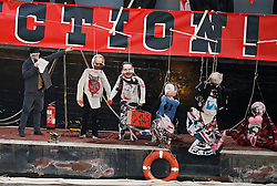 "© Licensed to London News Pictures. 26/11/2016. London, UK. JOE CORRE stands next to effigies of TONY BLAIR, GEORGE OSBORNE, DAVID CAMERON, BORIS JOHNSON and THERESA MAY wearing punk memorabilia. Joe Corre, the son of former Sex Pistol manager Malcolm McLaren and Vivienne Westwood burns his personal collection of Sex Pistols punk memorabilia. Earlier this week Joe Corre said that punk has become nothing more than a ""McDonald's brand ... owned by the state, establishment and corporations"". His collection is estimated to be worth £5 million. Photo credit: Peter Macdiarmid/LNP"