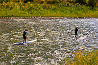 Stand up paddle boarding on the Colorado River in Glenwood Canyon, near Glenwood Springs, Colorado USA