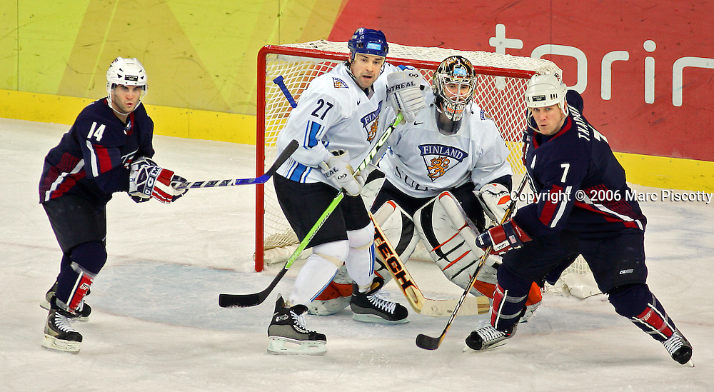 Finland's goaltender Antero Niittymaki (#31) tries to see the action between teammate Teppo Numminen (#27) and U.S. players Brian Gionta (#14) and Keith Tkachuk (#7) as they try to create traffic in front of the net during the second period of their Quarterfinal game at the Palasport Olimpico in Turin, Italy on Wednesday February 22, 2006. The U.S. Hockey Team lost the game 3-4 and was eliminated from medal contention..(Photo by Marc Piscotty / © 2006)