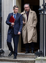 © Licensed to London News Pictures. 18/12/2018. London, UK. Defence Secretary Gavin Williamson (L) and Attorney General Geoffrey Cox QC (R) leave 10 Downing Street after the Cabinet meeting. Tomorrow will mark 100 days to go before the 29 March 2019 deadline for leaving the European Union. Photo credit: Rob Pinney/LNP