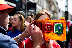 A Wales fan having face paint<br /> <br /> Photographer Simon King/Replay Images<br /> <br /> Friendly - Wales v Ireland - Saturday 31st August 2019 - Principality Stadium - Cardiff<br /> <br /> World Copyright © Replay Images . All rights reserved. info@replayimages.co.uk - http://replayimages.co.uk