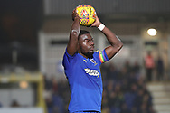 AFC Wimbledon defender Deji Oshilaja (4) about to take a throw in wearing captains armband during the EFL Sky Bet League 1 match between AFC Wimbledon and Southend United at the Cherry Red Records Stadium, Kingston, England on 24 November 2018.