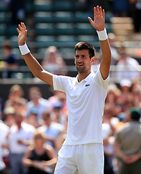 Novak Djokovic celebrates victory over Adam Pavlasek on day four of the Wimbledon Championships at The All England Lawn Tennis and Croquet Club, Wimbledon.