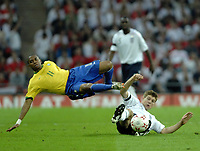 Photo: Richard Lane.<br />England v Brazil. International Friendly. 01/06/2007. <br />England's Steven Gerrard tackles  Brazil's Robinho (lt).