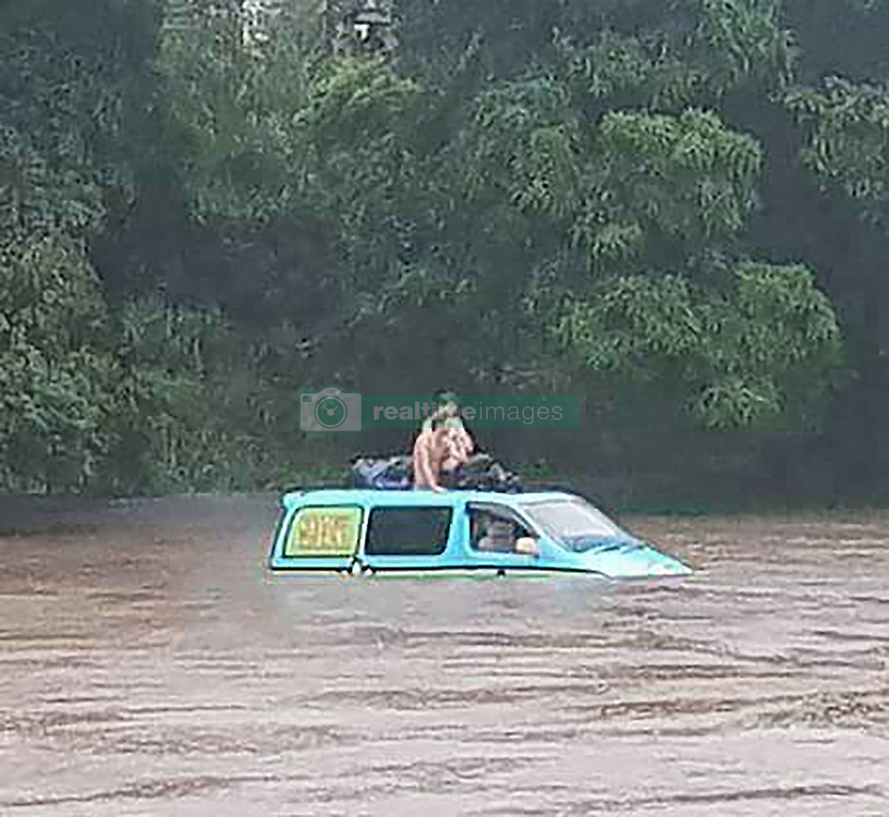 EXCLUSIVE: Pic shows Australian emergency services before they rescued three UK tourists stranded on top of their camper van. Three British backpackers had to be rescued when they woke up in their camper van to find they were surrounded by croc infested floodwater. The unhappy campers called emergency crews around 6am (local time) today (TUES) when they became flooded at Green Patch, a camping ground south of Cairns, Queensland, Australia. Officers from Queensland Fire and Emergency Services (QFES) arrived at the campsite to find three tourists – two male and one female - from the UK cowering on the roof of the Scooby-Doo-like coloured hire vehicle. It's understood the Brits feared the water could be hiding man eating saltwater crocodiles which are common in Queensland and can grow up to 16-foot long. Nearby signs indicated that the area was a crocodile warning area and locals said there were resident reptiles in the murky water. (see Magnus copy) pictures@magnusnewsagency.com +44(0)1214584402. 06 Feb 2018 Pictured: Pic from Magnus News Agency. Pic shows the camper van surrounded by floodwater. Three British backpackers had to be rescued when they woke up in their camper van to find they were surrounded by croc infested floodwater. The unhappy campers called emergency crews around 6am (local time) today (TUES) when they became flooded at Green Patch, a camping ground south of Cairns, Queensland, Australia. Officers from Queensland Fire and Emergency Services (QFES) arrived at the campsite to find three tourists – two male and one female - from the UK cowering on the roof of the Scooby-Doo-like coloured hire vehicle. It's understood the Brits feared the water could be hiding man eating saltwater crocodiles which are common in Queensland and can grow up to 16-foot long. Nearby signs indicated that the area was a crocodile warning area and locals said there were resident reptiles in the murky water. (see Magnus copy) pictures@magnusnewsagency.com +44(0)12145844