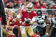 San Francisco 49ers quarterback Jimmy Garoppolo (10) hands the ball off against the Jacksonville Jaguars at Levi's Stadium in Santa Clara, Calif., on December 24, 2017. (Stan Olszewski/Special to S.F. Examiner)
