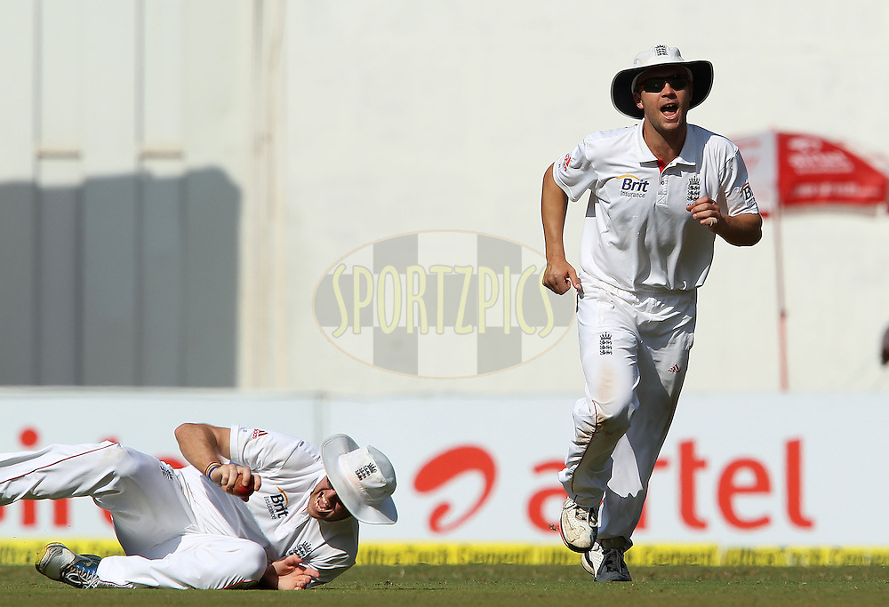 Jonathan Trott of England and Graeme Swann of England celebrate the wicket of Mahendra Singh Dhoni - Captain of India during day 1 of the 2nd Airtel Test match between India and England held at the Wankhede Stadium in Mumbai, India on the 23rd November 2012...Photo by Ron Gaunt/ BCCI/ SPORTZPICS..Use of this image is subject to the terms and conditions as outlined by the BCCI. These terms can be found by following this link:..http://www.sportzpics.co.za/image/I0000SoRagM2cIEc