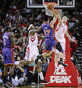 Jan 28, 2012; Houston, TX, USA; New York Knicks point guard Jeremy Lin (17) shoots over Houston Rockets small forward Chase Budinger (10) and center Jordan Hill (27) during the fourth quarter at the Toyota Center. The Rockets won 97-84. Mandatory Credit: Thomas Campbell-US Presswire