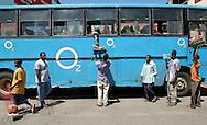 Food vendors sell items to bus passengers in Malindi, Kenya on Friday, May 12, 2006.