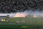 Matt Kenseth (20) slips past while drivers spin into the infield as David Gilliland, top left, and Justin Allgaier (51) hit the wall during a NASCAR Sprint Cup Series auto race at Kansas Speedway in Kansas City, Kan., Saturday, May 10, 2014. (AP Photo/Colin E. Braley)