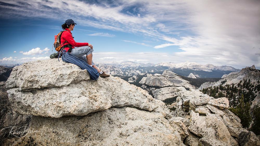 Rock climber on the summit of Tenaya Peak, Tuolumne Meadows, Yosemite National Park, California USA