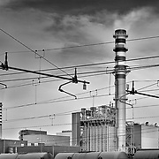 Mantova, Italy, Lombardy:  Exterior view of the distillery factory at railway station. Signed and editioned prints available at 50x40cm. Get and touch, for commercial uses or other sizes.. Photographs by Alejandro Sala | Visit Shop Images to purchase and download a digital file and explore other Alejandro-Sala images…