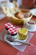 French jam honey butter bread and pain au chocolat breakfast at Hostellerie Les Griffons, Bourdeilles, Dordogne, France