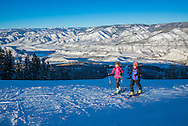 Skiers skin up Buttermilk Mountain in Aspen, Colorado.