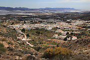 View over village house and plastic farming in the valley from Nijar, Almeria, Spain