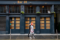 Glasgow, Scotland, UK.1 December 2020. Glasgow remains under level 4 lockdown and non essential businesses, bars and restaurants are closed. Pictured; Bar 91 in the Merchant city is closed and boarded up.  Iain Masterton/Alamy Live News