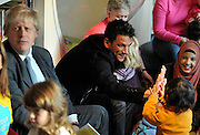 © Licensed to London News Pictures. 06/12/2011, London, UK. PETER ANDRE claps hands with a child during games with the children at the library. BORIS JOHNSON and PETER ANDRE launch  the Love Libraries scheme at Shepherds Bush Library, London, Today 6th December. Love Libraries is a new scheme to encourage Londoners to read and participate in activities at their local libraries. Photo credit : Stephen Simpson/LNP