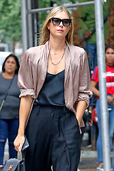 EXCLUSIVE: Maria Sharapova steps out wearing a pink satin top and YSL handbag, NYC. 11 Sep 2018 Pictured: Maria Sharapova. Photo credit: MEGA TheMegaAgency.com +1 888 505 6342