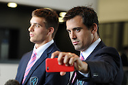 Uruguay rugby player Andres Vilaseca (l) gives an interview as Uruguay rugby captain Santiago Vilaseca ® takes a photograph. Uruguay 2015 World Cup team welcoming ceremony at the Royal Welsh College of Music and Drama in Cardiff, Wales.on Monday 14th Sept 2015.<br /> pic by Andrew Orchard, Andrew Orchard sports photography.