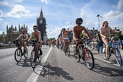 © Licensed to London News Pictures. 14/08/2021. London, UK. Participants in the Naked Bike Ride cycle through central London. Photo credit: Guilhem Baker/LNP